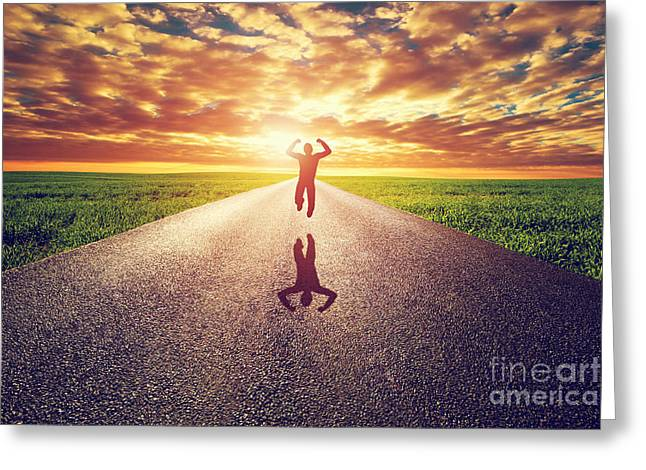Happy Man Greeting Cards - Happy man jumping on long straight road towards sunset sun Greeting Card by Michal Bednarek