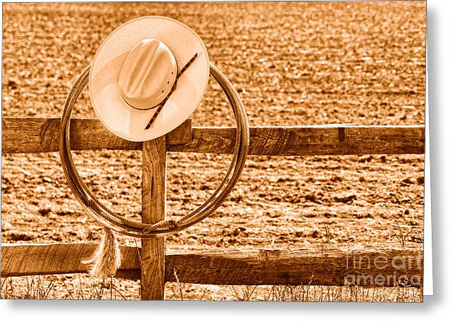 Hat And Lasso On A Fence - Sepia Greeting Card by Olivier Le Queinec