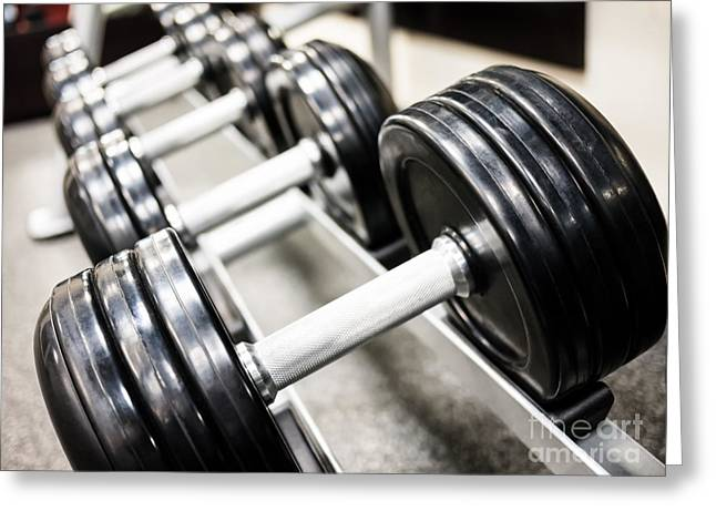 Healthclub Free Weights On A Rack Greeting Card by Paul Velgos