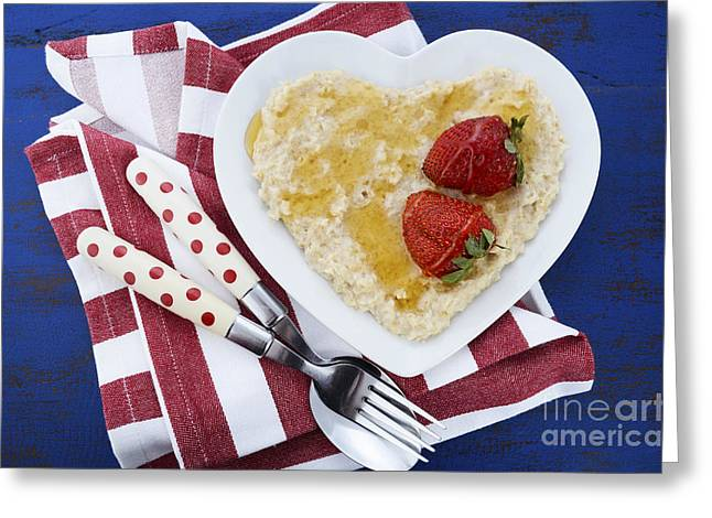 Porridge Greeting Cards - Healthy breakfast oats on heart shape plate Greeting Card by Milleflore Images
