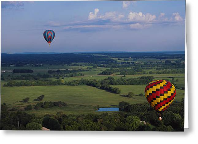 Mid Air Greeting Cards - Hot Air Balloons Floating In The Sky Greeting Card by Panoramic Images