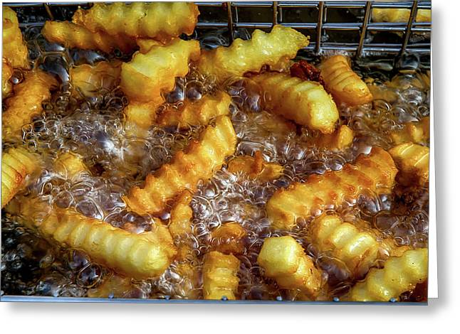 Hot Golden Brown French Fries Greeting Card by John Haldane