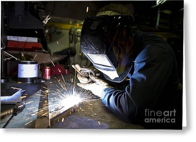 Hull Maintenance Technician Strikes Greeting Card by Stocktrek Images