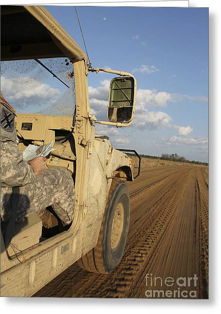 One Point Perspective Greeting Cards - Humvee Driving Down A Dirt Road Greeting Card by Stocktrek Images