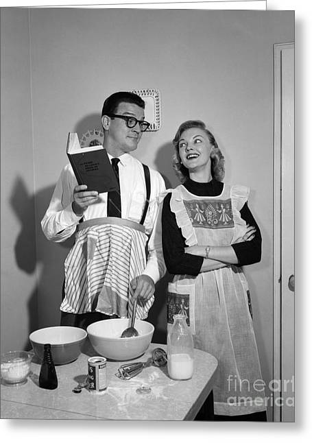 Husband Trying To Cook While Wife Looks Greeting Card by Debrocke/ClassicStock