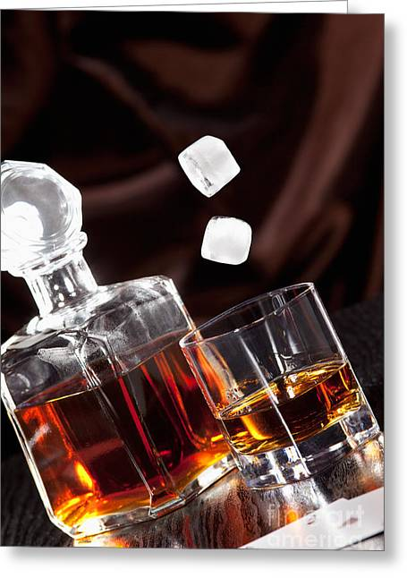 Drink Greeting Cards - Ice cubes falling into a glass of Whisky Greeting Card by Wolfgang Steiner