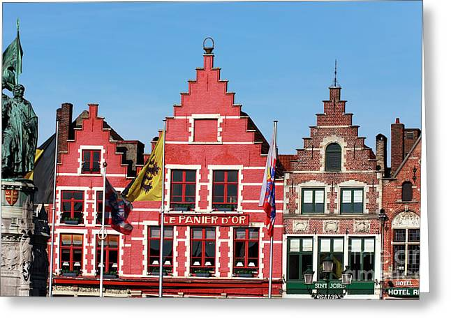 Red Buildings Greeting Cards - In Bruges Greeting Card by John Rizzuto