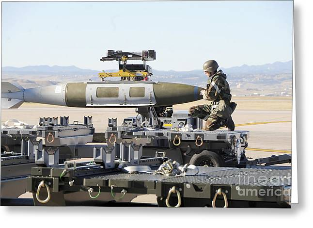 Irman Assists In Lowering A Guided Bomb Greeting Card by Stocktrek Images