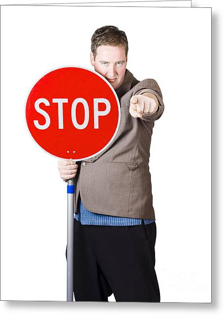 Pause Greeting Cards - Isolated man holding red traffic stop sign Greeting Card by Ryan Jorgensen