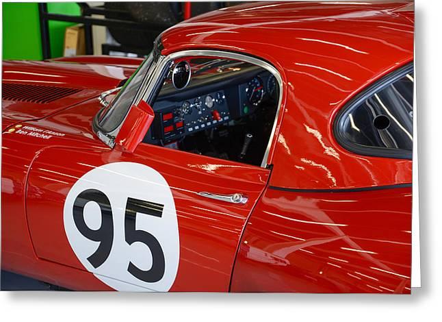 Jaguars Greeting Cards - Racing red Jaguar 95 Greeting Card by Graham Smith