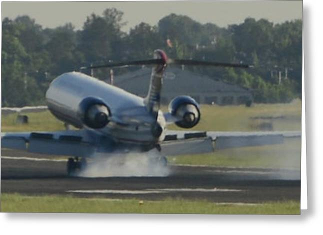 Jet Plane Landing On Runway With Tires Smoking Greeting Card by David Oppenheimer