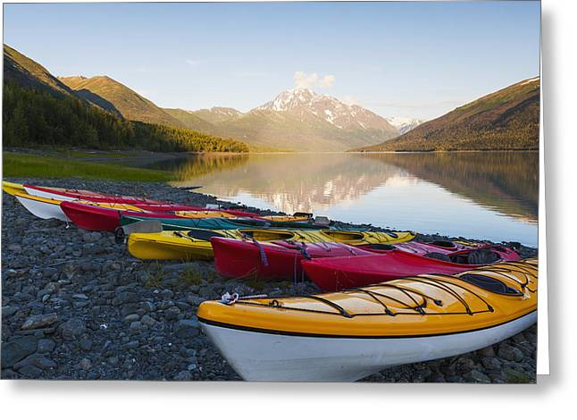 Boats In Reflecting Water Photographs Greeting Cards - Kayaks On The Shore Of Eklutna Lake Greeting Card by Michael DeYoung