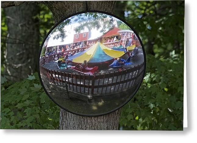 Kiddie Rides Greeting Cards - Kiddie Ride Reflection in a Round Mirror Greeting Card by Matt Plyler
