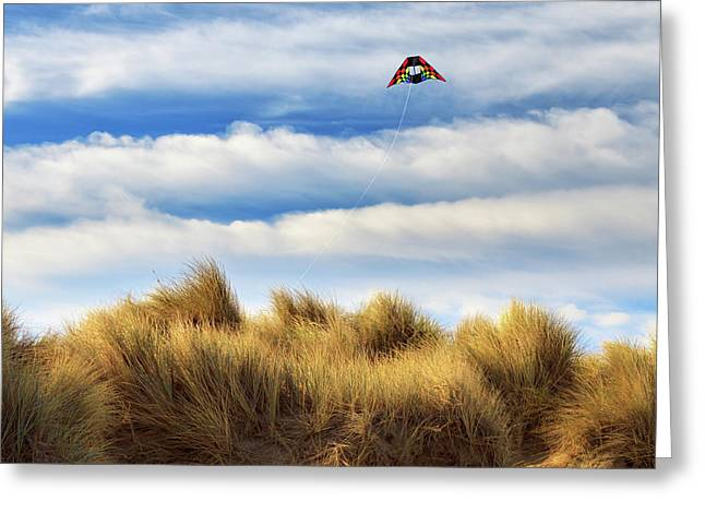 Kite Over The Hill Greeting Card by James Eddy