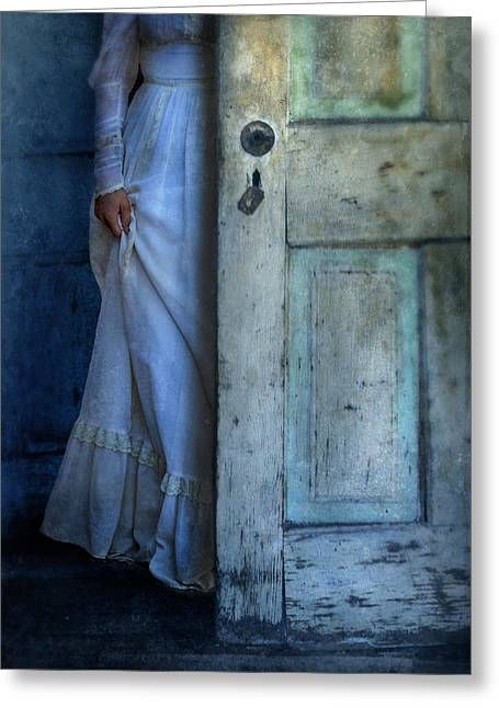 Run Down Greeting Cards - Lady in Vintage Clothing Hiding Behind Old Door Greeting Card by Jill Battaglia