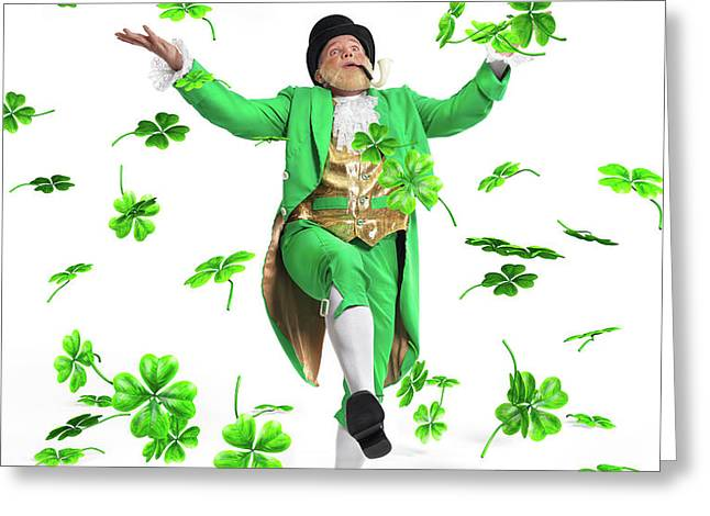 Leprechaun Tossing Shamrock Leaves up in the Air Greeting Card by Oleksiy Maksymenko