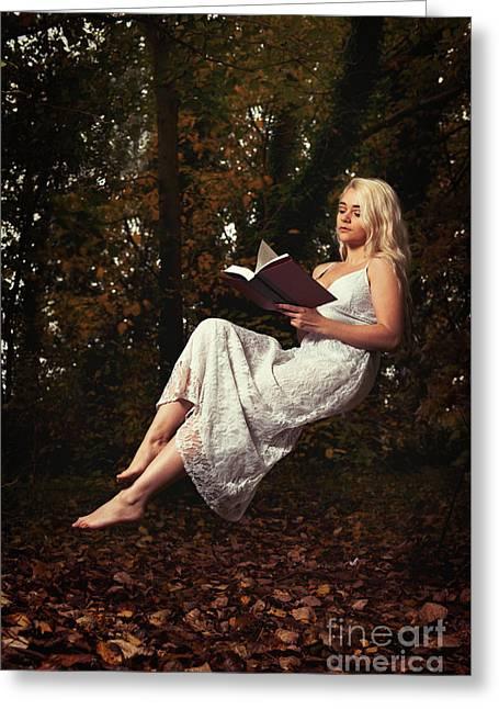 Levitation With Book Greeting Card by Amanda Elwell