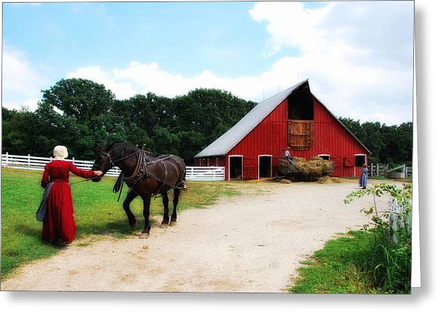 Lyle Huisken Greeting Cards - Lifting Hay Greeting Card by Lyle  Huisken