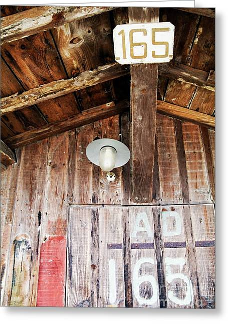 Bassin Greeting Cards - Light hanging inside an old wooden hut Greeting Card by Sami Sarkis