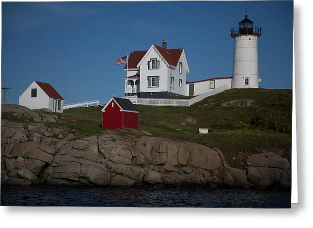 Sheds Greeting Cards - Lighthouse With Red Shed And White Fence Greeting Card by Mark Beecher