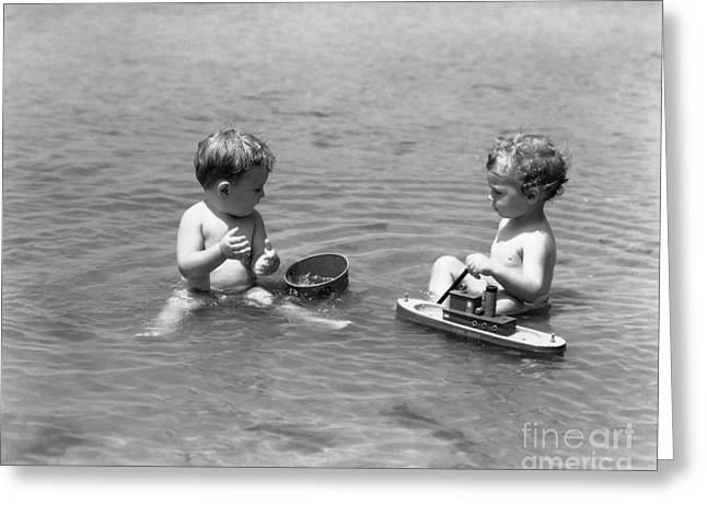 Little Boys Playing In The Ocean Greeting Card by H. Armstrong Roberts/ClassicStock