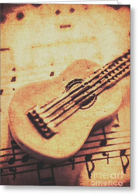 Little Carved Guitar On Sheet Music Greeting Card by Jorgo Photography - Wall Art Gallery
