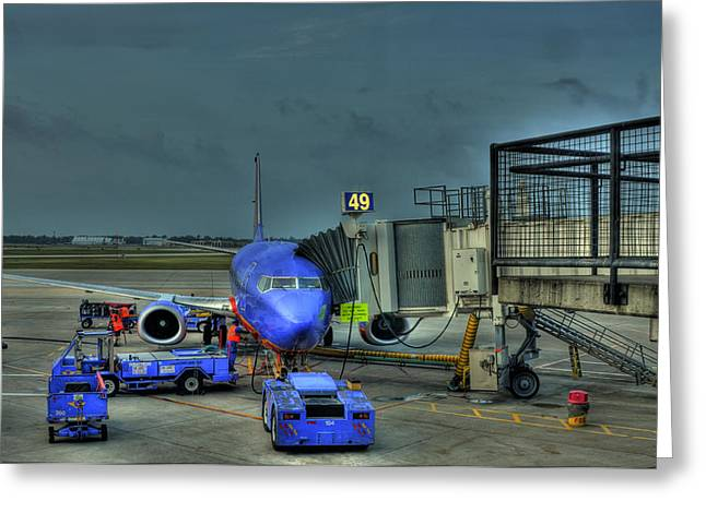 Loading Luggage Greeting Card by Don Wolf