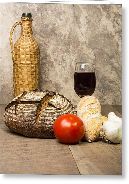 Loaf Of Bread Greeting Cards - Loaf of fresh rye bread on a table Greeting Card by John Trax