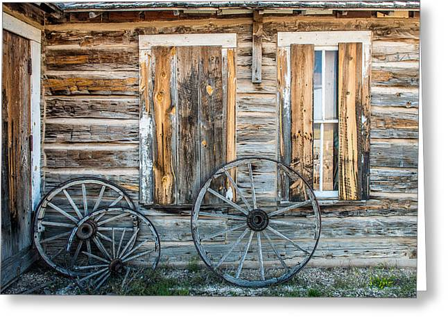 Log Cabins Greeting Cards - Log cabin And wagon Wheels Greeting Card by Paul Freidlund