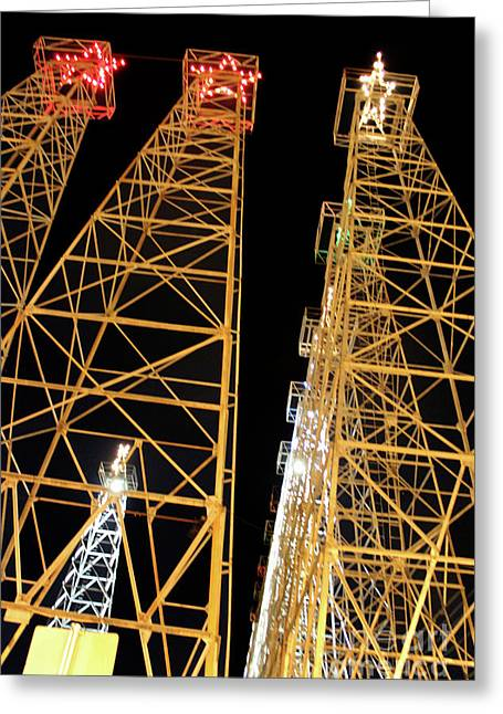Looking Up At The Kilgore Lighted Derricks Greeting Card by Kathy  White