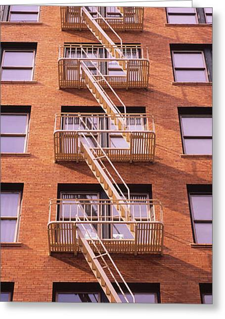Low Angle View Of Fire Escape Ladders Greeting Card by Panoramic Images