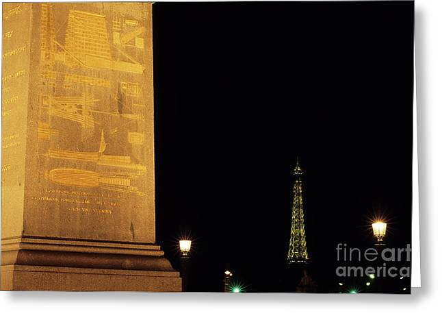 Streetlight Greeting Cards - Luxor Obelisk in the Concorde Plaza with view of the Eiffel Tower illuminated at night Greeting Card by Sami Sarkis