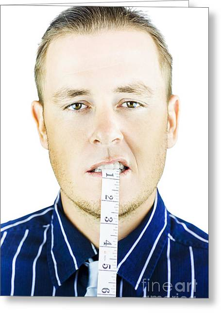 Clenched Teeth Greeting Cards - Man biting tape measure Greeting Card by Ryan Jorgensen