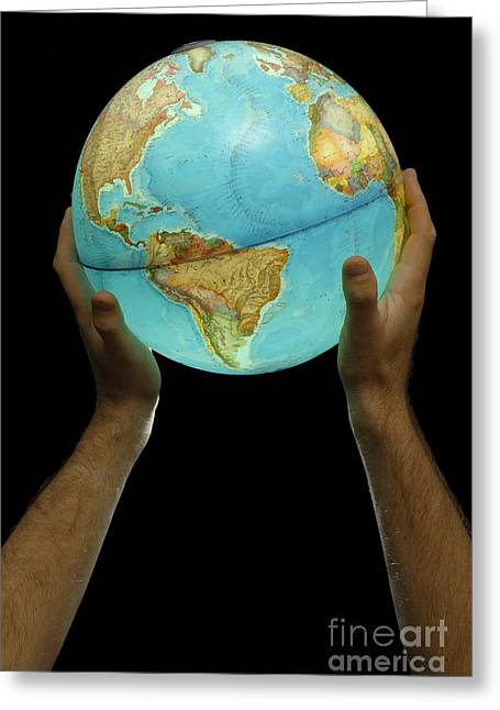 Person Of Color Greeting Cards - Man holding illuminated Earth globe Greeting Card by Sami Sarkis