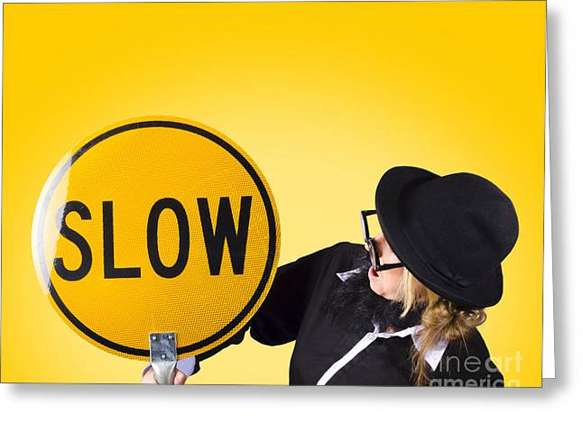 Working Conditions Greeting Cards - Man holding slow sign during adverse conditions Greeting Card by Ryan Jorgensen