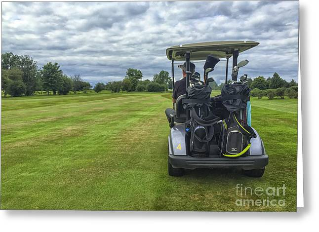 Cart Driving Greeting Cards - Man in golf buggy on course Greeting Card by Patricia Hofmeester