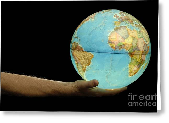 Person Of Color Greeting Cards - Man offering illuminated Earth globe Greeting Card by Sami Sarkis