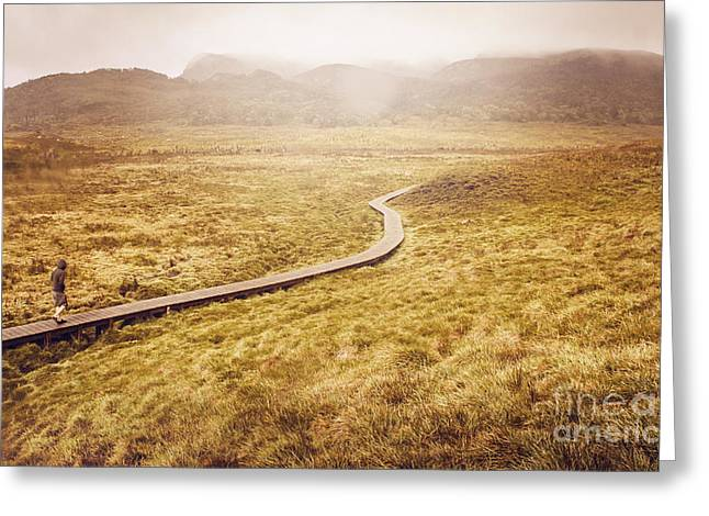 Cradle-mountain Greeting Cards - Man on expedition along Cradle Mountain Boardwalk Greeting Card by Ryan Jorgensen