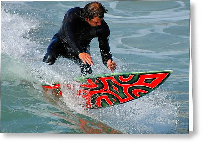 Californian Greeting Cards - Man on Orange and Black Surfboard Greeting Card by Clarence Alford