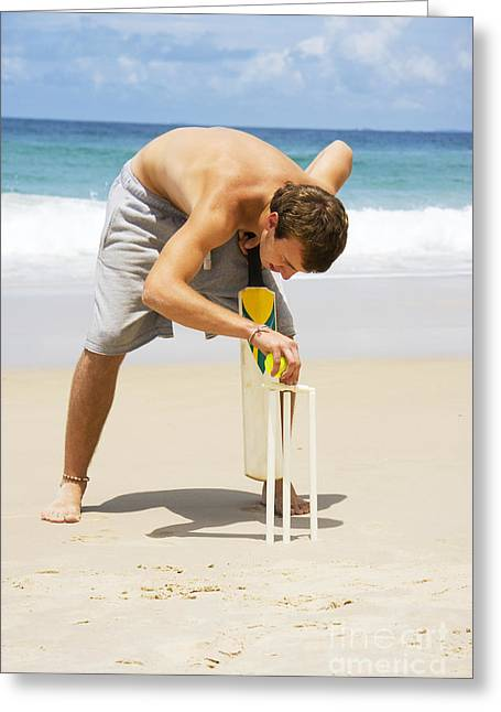 Perfect Game Greeting Cards - Man Playing Beach Cricket Greeting Card by Ryan Jorgensen