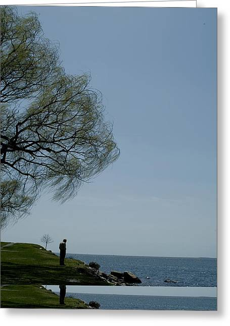 Groton Greeting Cards - Man Standing On A Rocky Seashore Greeting Card by Todd Gipstein