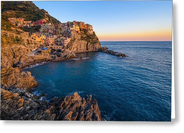 Buildings By The Sea Photographs Greeting Cards - Manarola village and the sunset show Greeting Card by Catalin Tibuleac