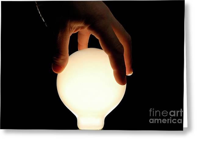 One Mature Man Only Greeting Cards - Mans hand on illuminated light bulb Greeting Card by Sami Sarkis