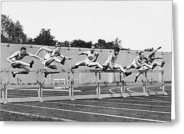 Hurdles Greeting Cards - Men Running High Hurdles Greeting Card by Underwood Archives
