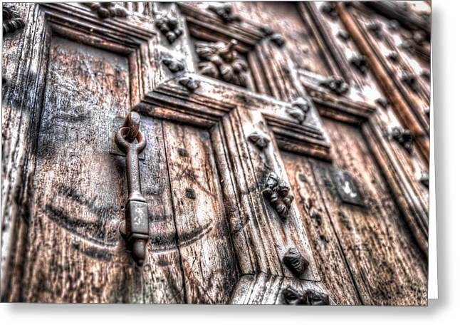 French Doors Greeting Cards - Metal door knocker on a heavy relief door Greeting Card by Semmick Photo