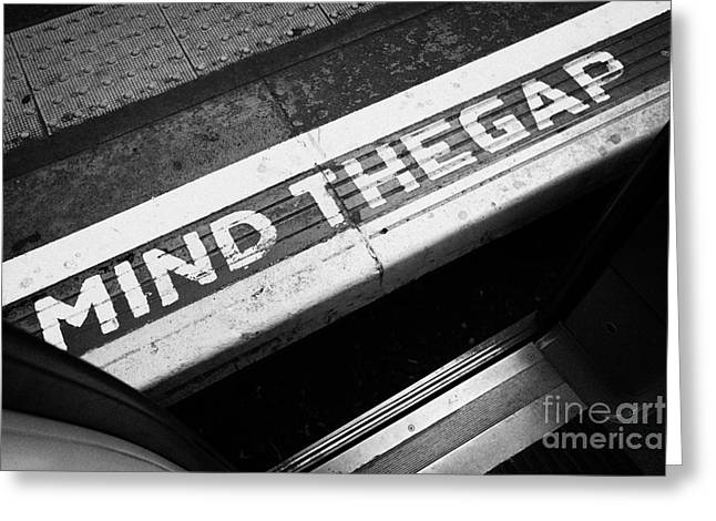 mind the gap between platform and train at london underground station england united kingdom uk Greeting Card by Joe Fox