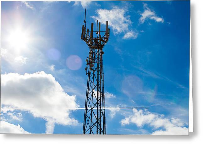 Transmitter Greeting Cards - Mobile phone mast with a blue sky behind Greeting Card by Fizzy Image
