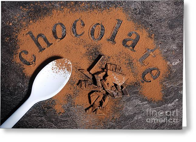 Menu Greeting Cards - Modern aerial view of chocolate on black slate bench top Greeting Card by Milleflore Images