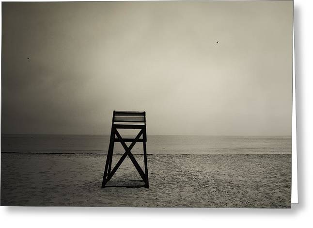 Empty Chairs Greeting Cards - Moody lifeguard stand on beach. Greeting Card by John Greim