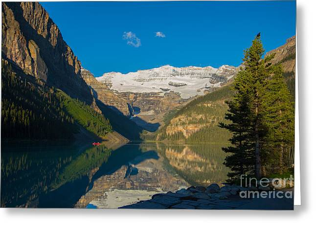 Snow Capped Greeting Cards - Morning Canoe Ride on Lake Louise Greeting Card by John Roberts
